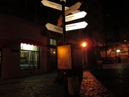 Signs pointing out mileage from Skadarska, Belgrade's bohemian district