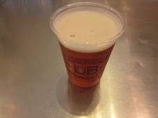 a sample of Lakefront's pumpkin brew, served in a bioplastic cup