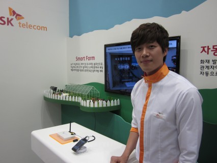 A young SK employee poses in front of his display