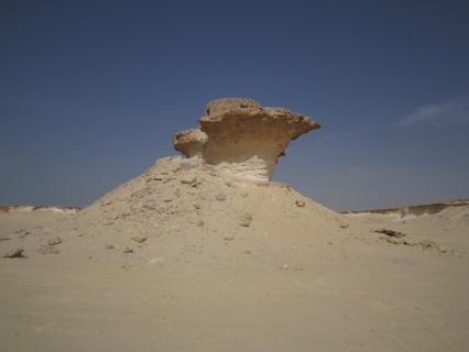 This outcrop offers stunning views of the Qatar Desert