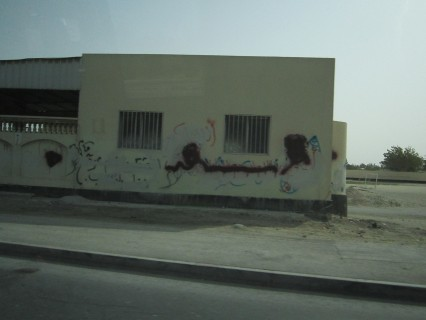 Anti-regime graffiti then covered in red paint buy the government-which brings more attention to dissent.